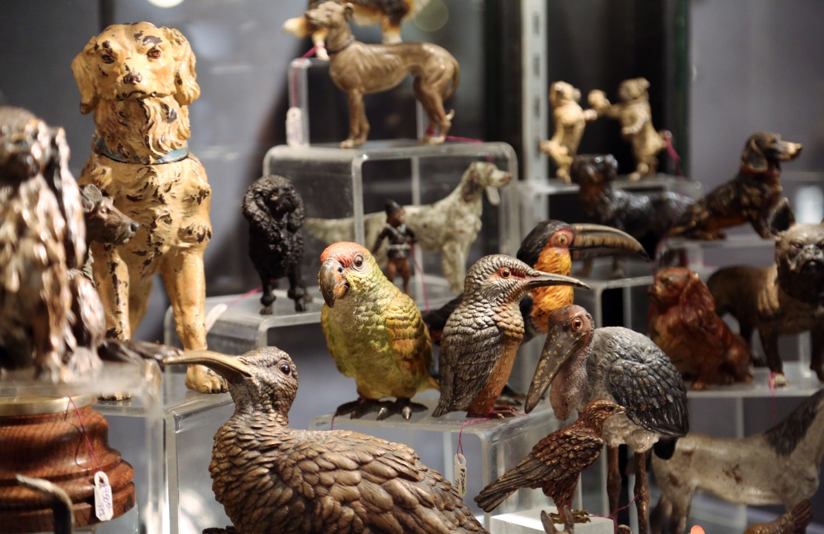 Leatherwood Antiques, Sandwich, Mass., featured its collection of Vienna bronzes. Shown are the more natural works in the form of birds and dogs.