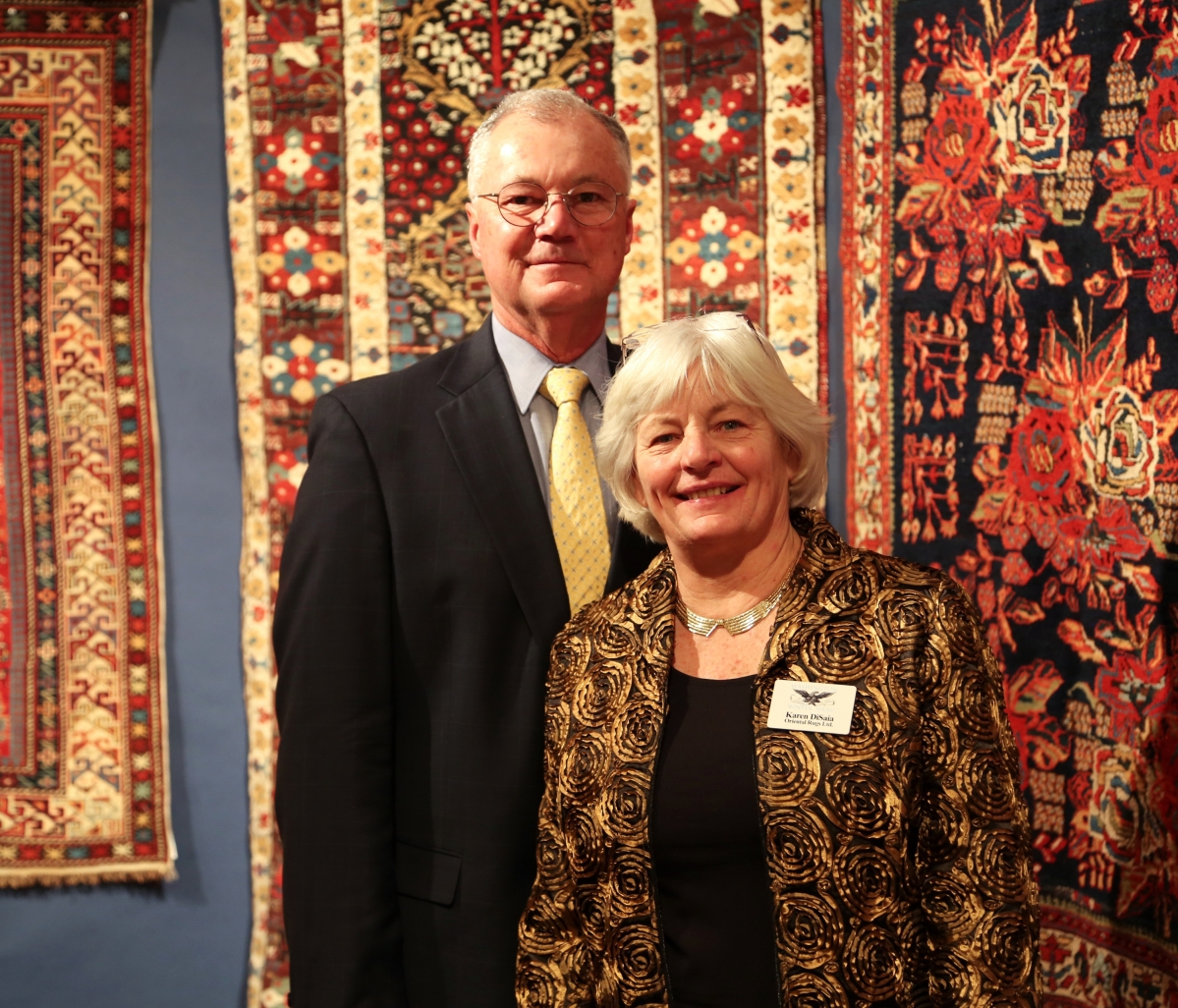 Ralph and Karen DiSaia, show managers, with their vibrant Oriental carpets in the background.