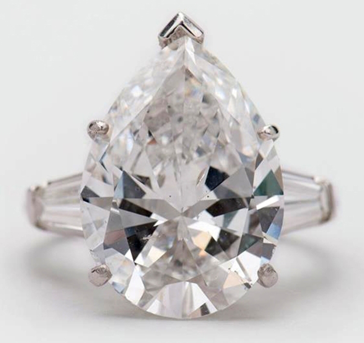 The highest price of the sale, $103,700, was achieved by this GIA-certified 9.19-carat platinum and diamond ring. It was prong-set with a pear-shape diamond, flanked by two tapered baguettes. Numerous phone bidders competed with the internet and a determined bidder in the room. Ultimately, the internet bidder was successful.