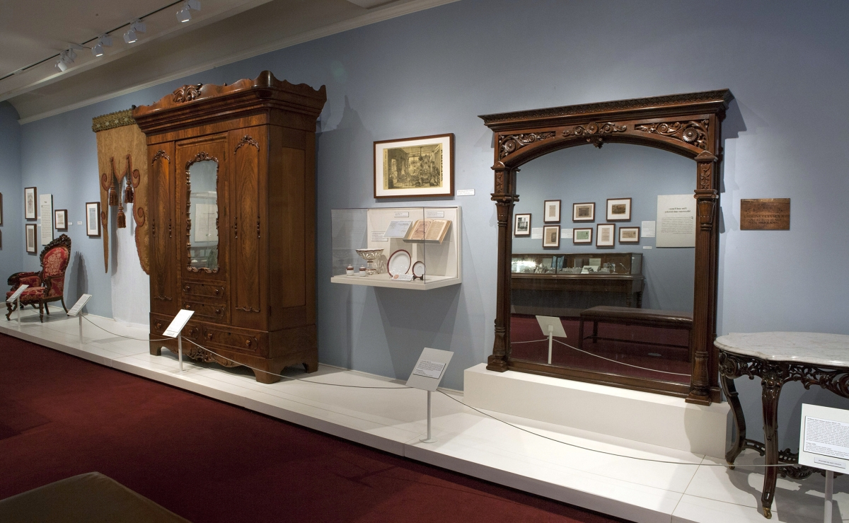 The main gallery features a rosewood overmantel mirror, circa 1860, retailed by French-born importer Laurent Uter and a massive mahogany armoire from the shop of Prudent Mallard, active 1838 to 1874.