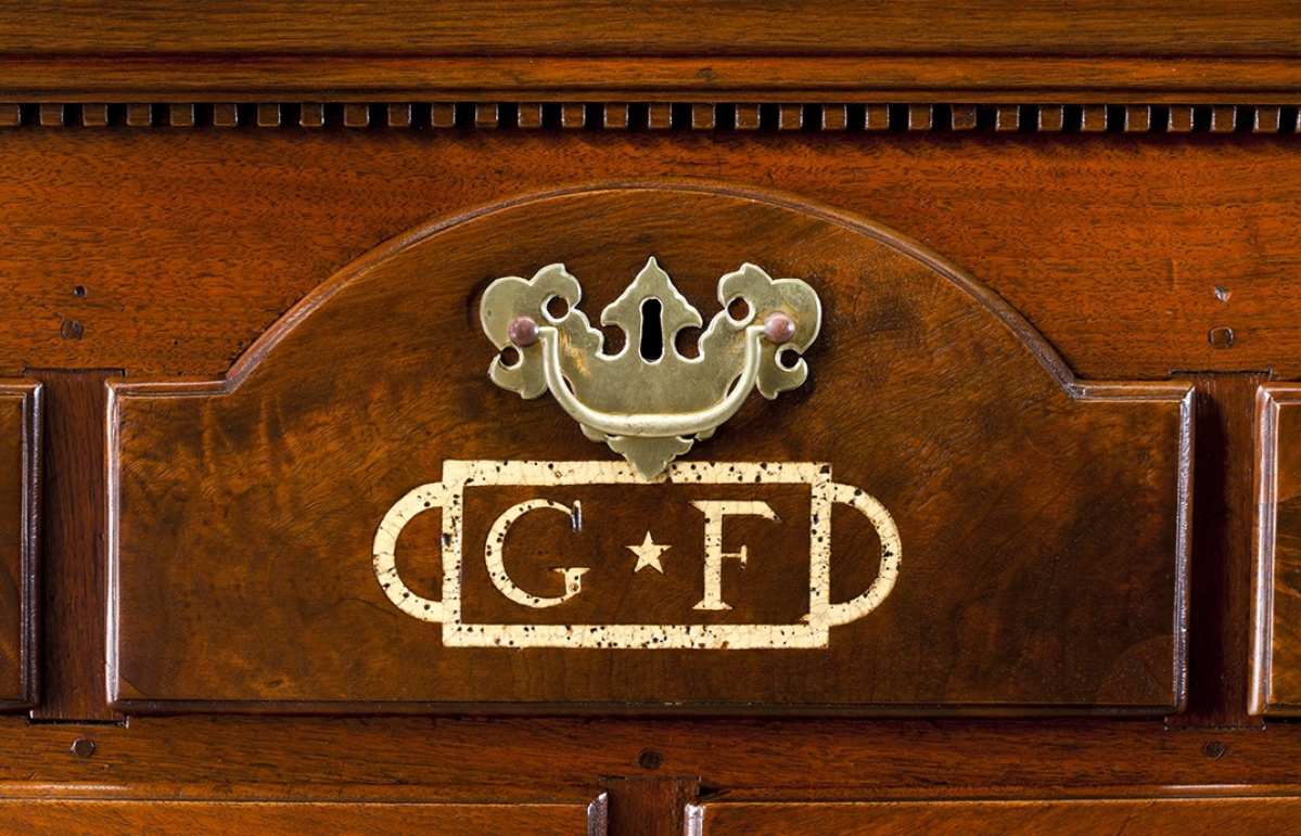 "The sulfur-inlaid initials ""G.F."" appear on the arched drawer front — a Chester County, Penn., design feature — of a 1796 chest of drawers probably made by Joseph Wells of Cane Creek, N.C., for George and Barbara Foust (Faust). Museum of Early Southern Decorative Arts"