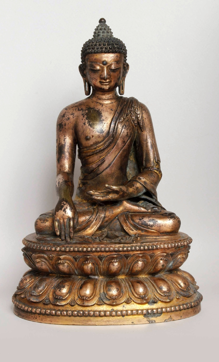 Buddha Shakyamuni, copper alloy with remains of mercury and lacquer gilding, China, Tibeto-Chinese style, Yuan, early Fourteenth Century, 9.37 inches high. Courtesy Dr Robert R. Bigler.