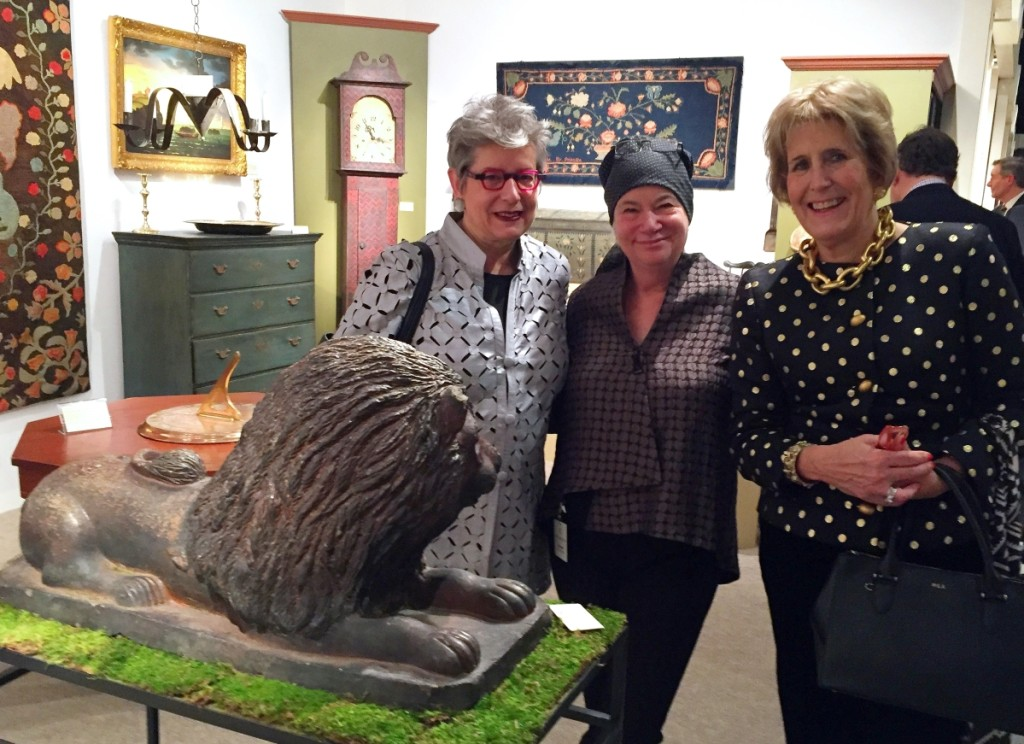 From left, Winterthur's chief curator Linda Eaton, Grace Snyder and dealer and show manager Diana Bittel examine a glazed stoneware lion of circa 1830 at Elliott & Grace Snyder Antiques, South Egremont, Mass.