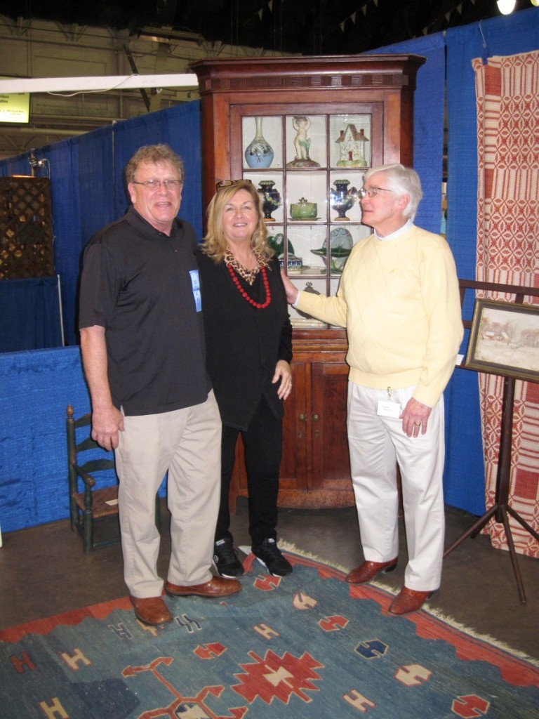 The show's promoter, Steve Allman and his wife, Judy, were chatting with dealer Steven White about the Bergen County, N.J., corner cupboard he sold during the show, just before it left the show floor.