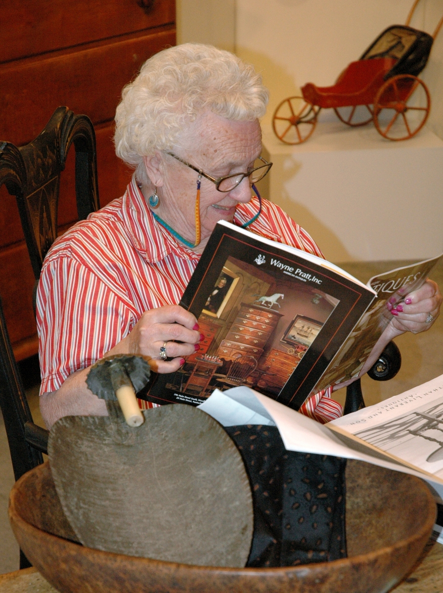 Pam often had her nose buried in an antiques publication when we stopped by to see her at a show. Here she peruses a magazine with her great friend Wayne Pratt's ad on its back cover.