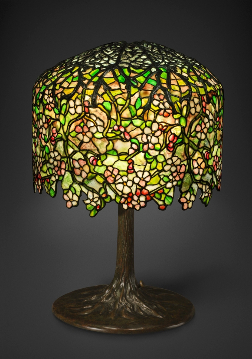 Tiffany Studios; probably designed by Clara Driscoll, Apple Blossom table lamp, circa 1901–06, glass, bronze.Gift of Dr Egon Neustadt. New-York Historical Society.