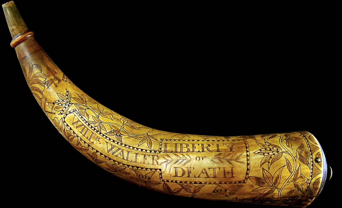 "The powder horn belonging to Virginian rifleman William Waller is inscribed ""Liberty or Death,"" ""Willm Waller,"" ""Appeal to Heaven"" and ""Kill or be Killd."" British and Hessian troops captured him after the fall of northern Manhattan's Fort Washington on November 16, 1776. Powder horn, Virginia, 1775–76. Horn (cow), wood, brass and ink."