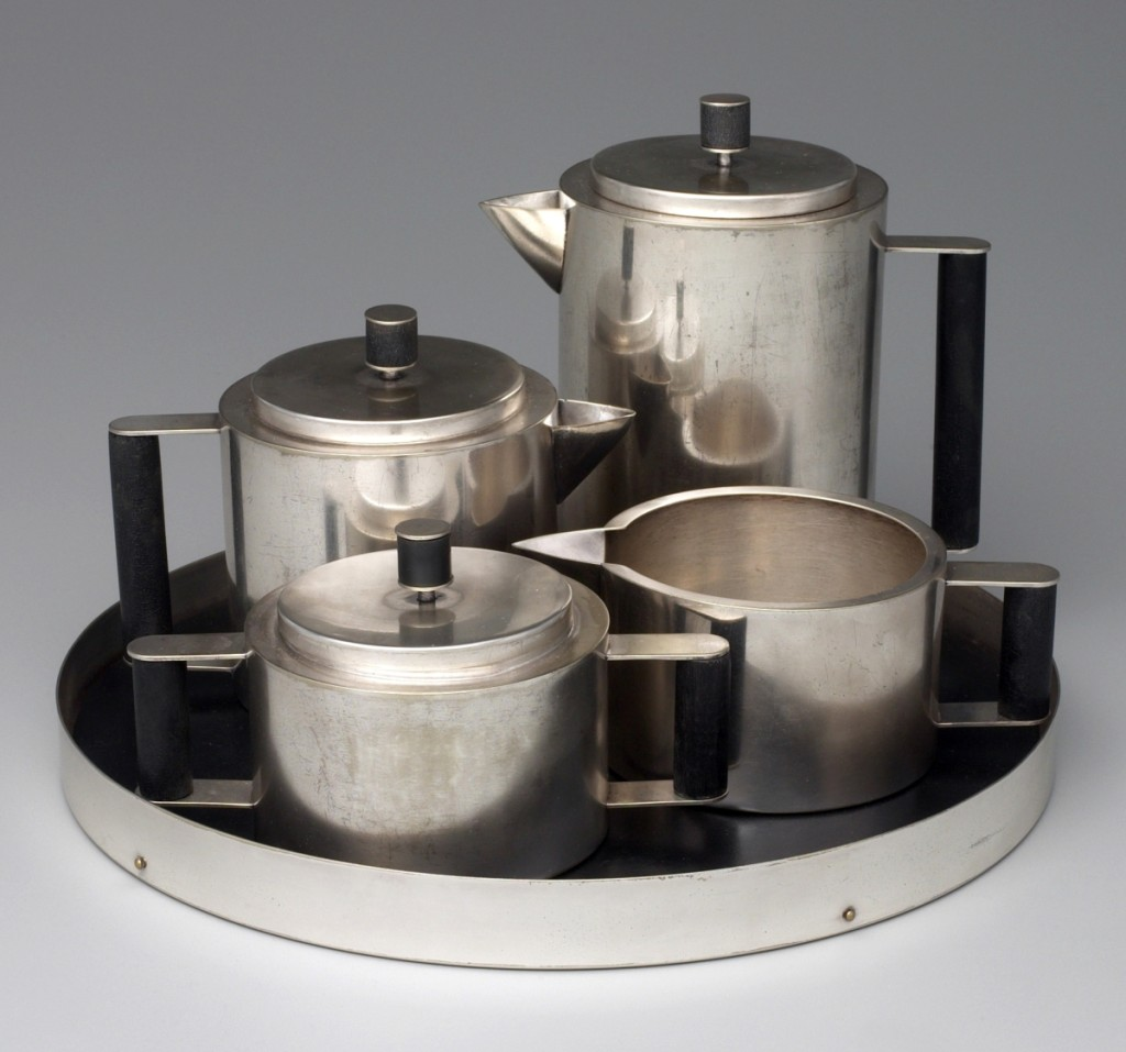 "A Modern Tea and Coffee ServiceTea and coffee service, designer Ilonka Karasz, Paye and Baker Manufacturing Company, 1928. Electroplated nickel silver and Bakelite with brass. Gift of M. Josephine Dial in memory of Gregory T. Dial, BS 1930, Fund.Shortly after the exhibition ""At Home in Manhattan: Modern Decorative Arts, 1925 to the Depression,"" on view at Yale in late 1983 into early 1984, I became aware that the Manhattan gallery Fifty-Fifty still had material from Ilonka Karasz's estate, including this service. One evening in New York my husband, Scott Braznell, harangued three curators — myself, Kevin Stayton of the Brooklyn Museum and Ulysses Dietz of Newark — about how this set had to be bought. He argued that it was a noteworthy work in American silver that eclipsed contemporaneous German Bauhaus silver. He analyzed its ingenious aspects of having all the pieces made with interchangeable parts from the same extruded cylinder for the bodies and the same rod of Bakelite for the handles. Furthermore, he noted it had belonged to Karasz herself. The exposition was delivered with such passion that the next day I called up dealer Mark McDonald and told him we wanted to pursue the purchase. The service has become an acknowledged icon of 1920s American design."