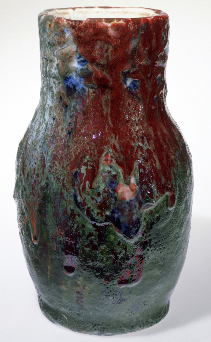 "A Volcanic VaseVase, designer Hugh C. Robertson, manufacturer Dedham Pottery, 1895–1908. Stoneware with ""volcanic"" glaze. Mabel Brady Garvan Collection, by exchange.When New Haven dealer and collector Rosalie Berberian decided to sell her collection of Arts and Crafts ceramics through Rago Auctions in 1993, we seized on the opportunity to buy rare examples of work by many of the well-known Arts and Crafts ceramists. Perhaps the star acquisition of the 14 lots we bought was this vase by Hugh Robertson. It is a monumental example of his experimental Volcanic Wares with a thick buildup of glazes ranging in color from blue and pale green to red luster."