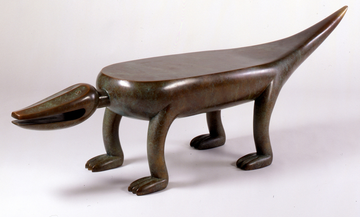 An Alligator BenchAlligator bench, designer Judy Kensley McKie, manufacturer Mussi Artworks Foundry, 1993. Bronze. Please Be Seated Collection, funded by Julian H. Fisher, BA, 1969, in memory of Wilbur J. Fisher, BA, 1926, and Janet H. Fisher.Yale alumnus Julian Fisher supported a Please Be Seated collection at Yale for a number of years, which allowed us to purchase works by contemporary makers to use as public seating in the galleries. Thereby we have assembled about 25 examples of seating furniture ranging in date from 1978 to 2006. Judy McKie began incorporating abstract animal imagery into her work in 1977 to develop a personalized sense of vitality that can be seen in her Alligator bench. Its playful stance and gaping grin make it a favorite with Art Gallery visitors.