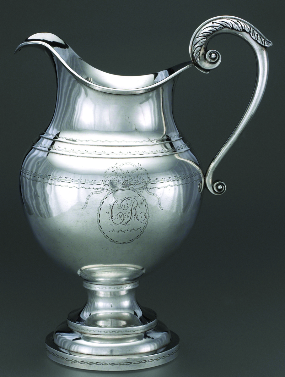 "A French-American PitcherPitcher by Antoine Oneille, 1810–15. Silver. Josephine Setze Fund for the John Marshall Phillips Collection.This silver pitcher was made between 1810 and 1815 in Sainte Genevieve, Mo., in what was known as the Illinois Country, which was settled by immigrants from France and French Canada. The region was ceded to Spain in 1762, returned to France in 1800 and sold to the United States as part of the Louisiana Purchase in 1803. French Canadian and Creole culture dominated in the area until the early Nineteenth Century. This pitcher's maker and owner were both of French descent. The maker, Antoine Oneille, was a Quebec-born silversmith who worked in Canada, Detroit and Vincennes, Ind., before arriving in Sainte Genevieve, where he largely made silver for the fur trade. The engraved initials ""CR"" inside a bright-cut medallion with a bowknot stand for Constance Roy and may have been part of her wedding silver when she married Ferdinand Rozier in Sainte Genevieve in 1812 or 1813. Other acquisitions followed. It has been said that we have the largest collection of central Mississippi Valley French silver of any museum."