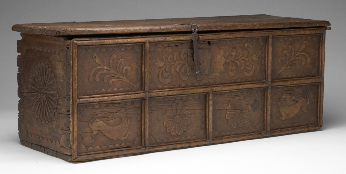 "A New Mexican ChestChest, maker unknown, 1775–1825. Probably ponderosa pine and iron. Mabel Brady Garvan Collection, by exchange.Under Spanish rule, the most typical piece of movable furniture that would be found in colonial New Mexican homes was the chest or ""caja."" This chest belongs to a group joined with dovetails and pegs and decorated with low-relief carving. The carved imagery, particularly the carved lions and pomegranates, heralds back to Spain. Chests with this distinctive construction and carving may have originated in the Rio Abajo area of New Mexico. Fewer early New Mexican chests survive than do colonial chests from the Atlantic coast. At the time the chest was purchased, it was the only New Mexican chest in a museum collection east of the Mississippi."