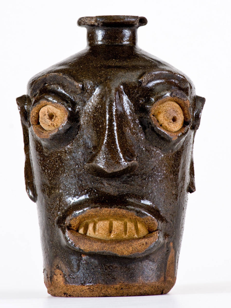 Fetching $33,040 was a rare Miles Mill, Edgefield, S.C., stoneware face jug.