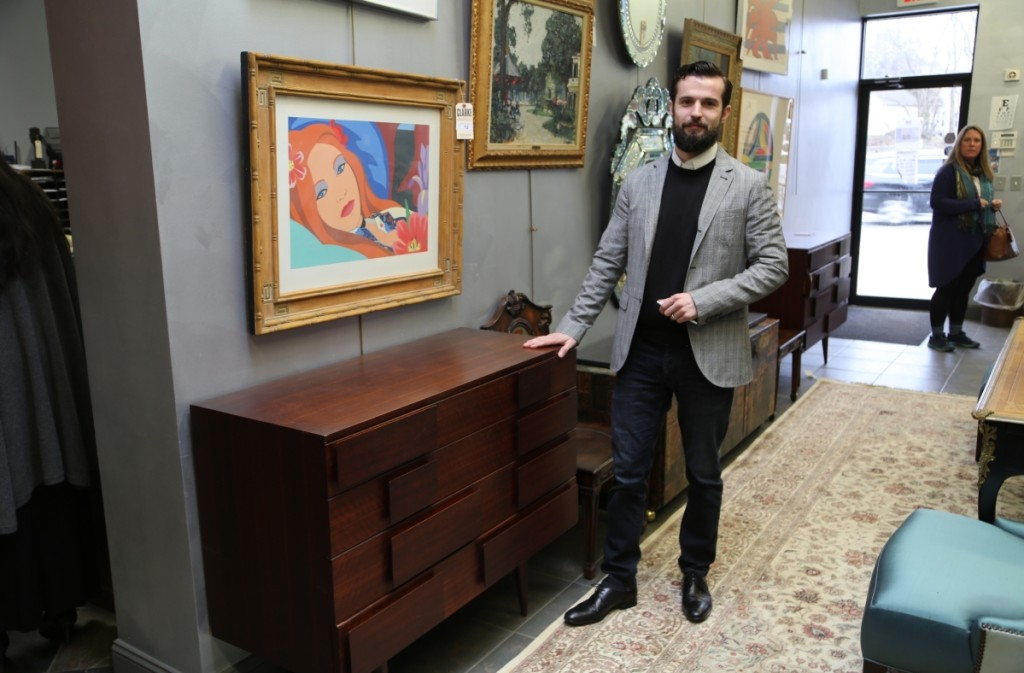 Design specialist Keane Ryan stands with a pair of Gio Ponti chests that produced the top selling lot of the sale at $40,000.