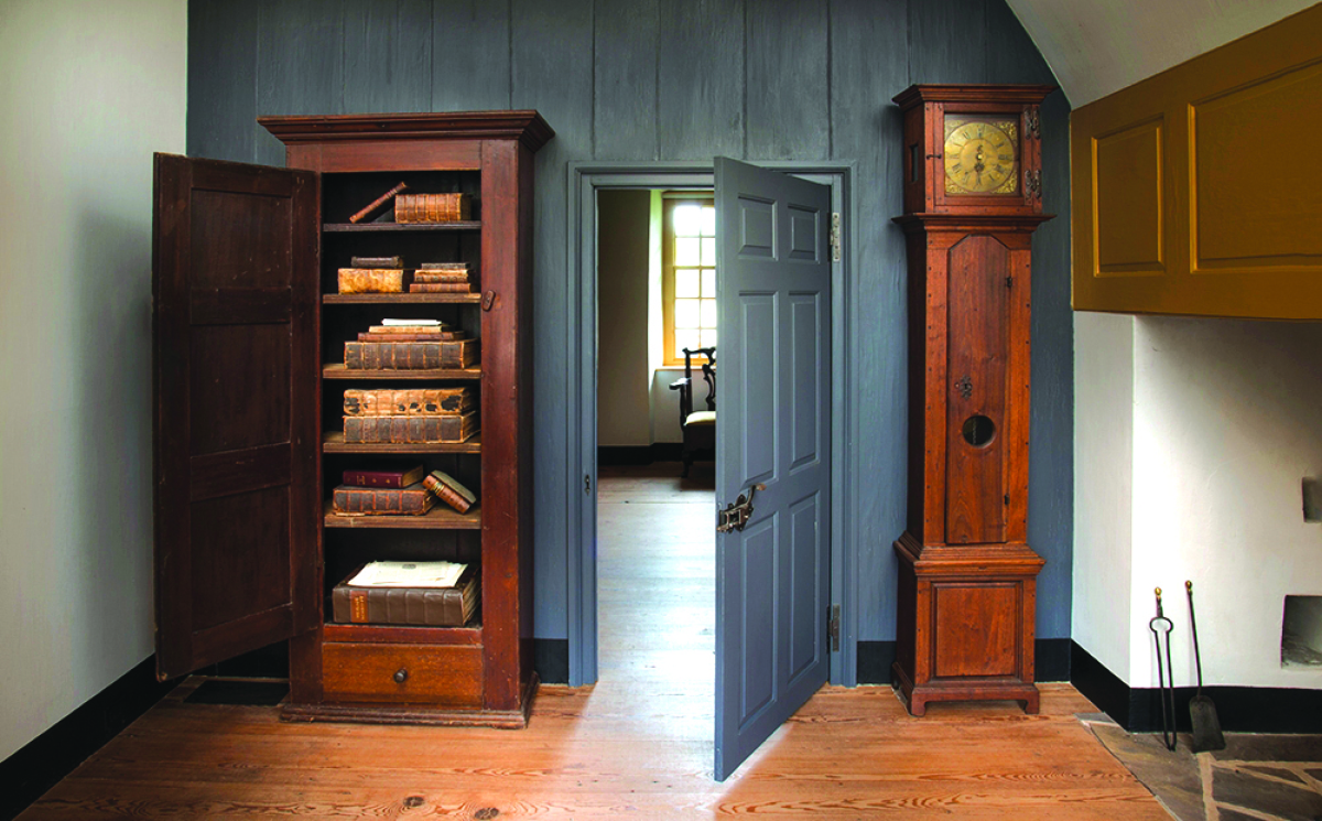 Figure 6. The bookcase holds Eighteenth Century German theological works, bibles and medical books. From his desk, Henry Muhlenberg could easily glance over at the clock, which is a 30-hour movement housed in a locally made walnut case. The ample use of wooden pegs in the case's construction indicates it was built by a German craftsman.