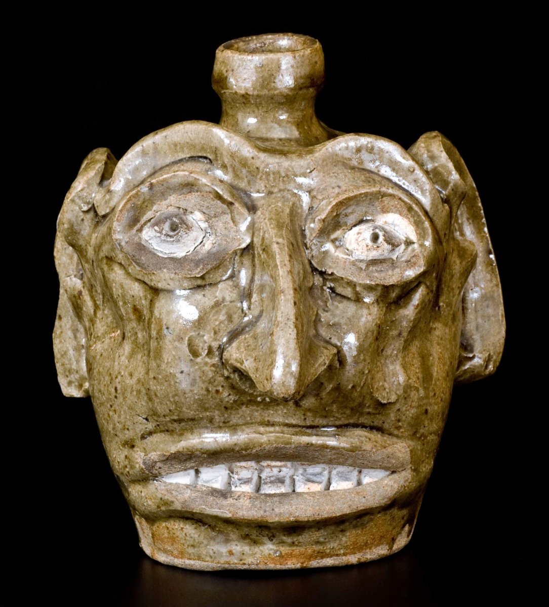 The sale's top lot was this folk art face jug, Edgefield, S.C., circa 1845–60, which sold for $47,200.