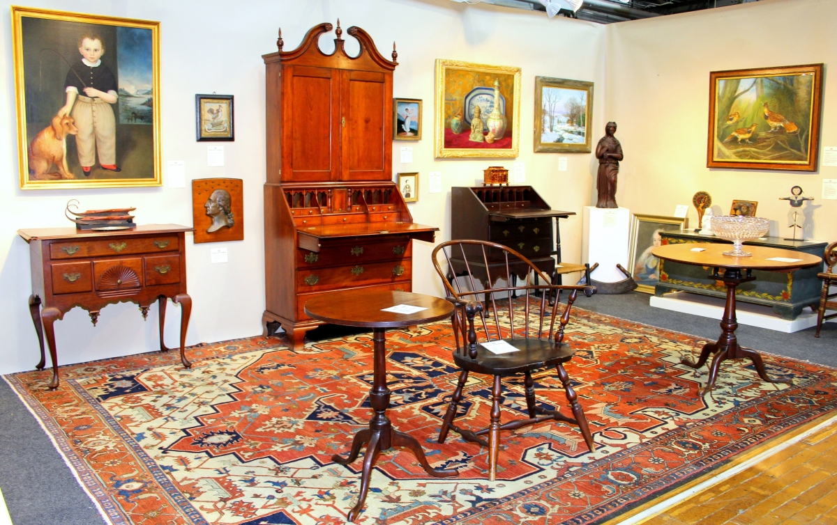 """With its original label from Bangor, Maine, """"Portrait of a Young Boy Standing with His Dog"""" dates to 1853 and is by George Gassner. The Hartford, Conn., area Chapin-style cherry secretary desk dates to around 1770. Jeffrey Tillou Antiques, Litchfield, Conn."""