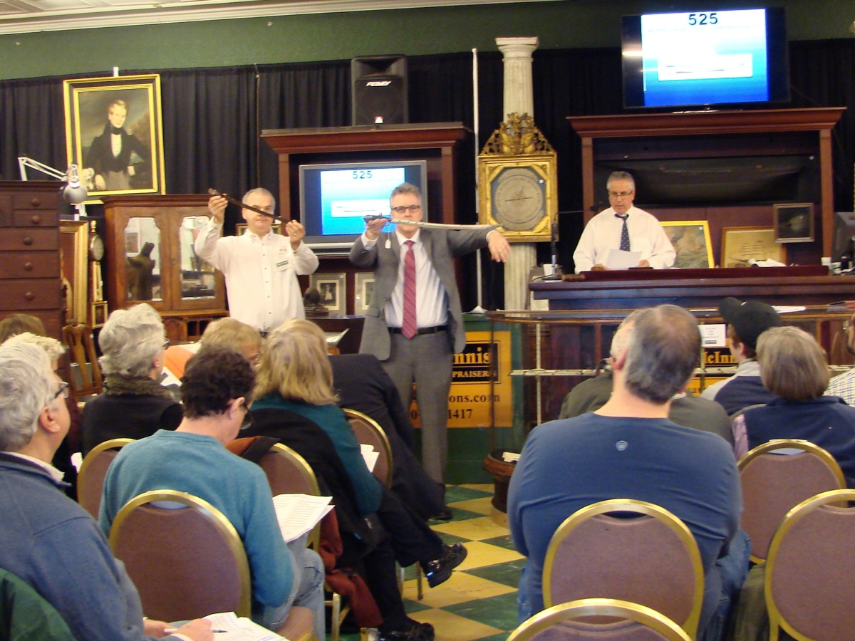 John McInnis selling the John Bailey sword that brought $102,000. It is being shown to the bidders in the room, one of whom was the successful bidder.