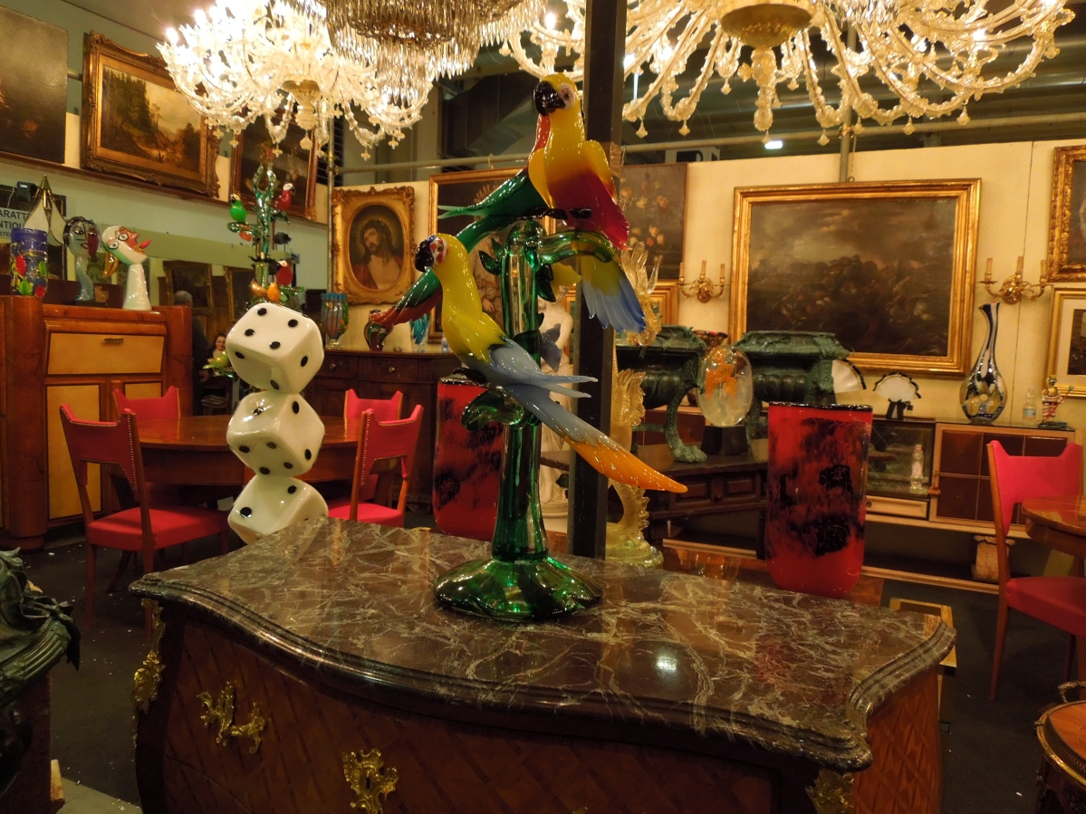 The brightly colored Venetian glass double parrot pedestal on a flared base struck a commanding presence. They were for sale at Capuzzo Andrea, Mesino, Italy.