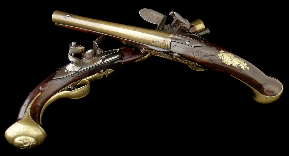 "Brigadier General John Muhlenberg of Trappe, Penn., carried these pistols engraved ""PM"" during the Revolutionary War. He led the Eighth Virginia Regiment, a corps of largely German-speaking soldiers from the Shenandoah Valley. Pistols, London, 1750–60. Walnut, brass, iron and steel."