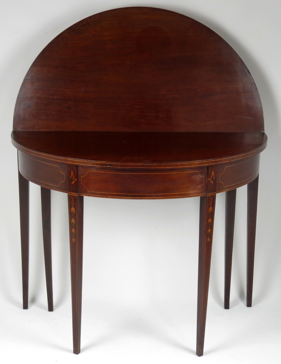 Selling for $10,200, this Newport six-legged, inlaid mahogany card table far exceeded the conservative estimate. It was attributed to the shop of Thomas and Samuel Goddard.