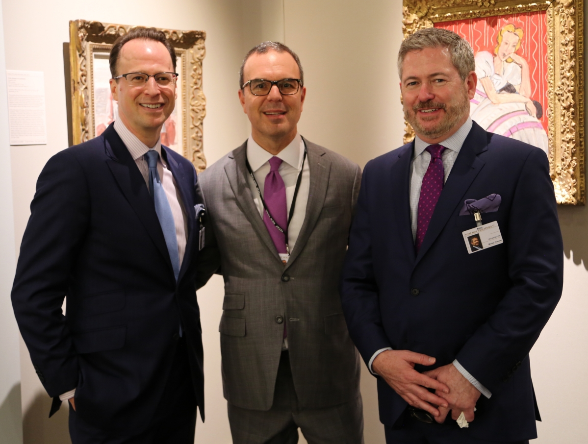 Managing directors Jeff Rabin, left, and Michael Plummer, right, stand with Howard Shaw, president and director of Hammer Galleries during the opening preview.
