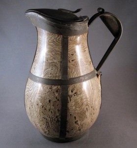 Staffordshire, England, agateware jug with pewter lid and tin replacement handle and bands, mid-Nineteenth Century with later alteration, 8¾ inches tall.