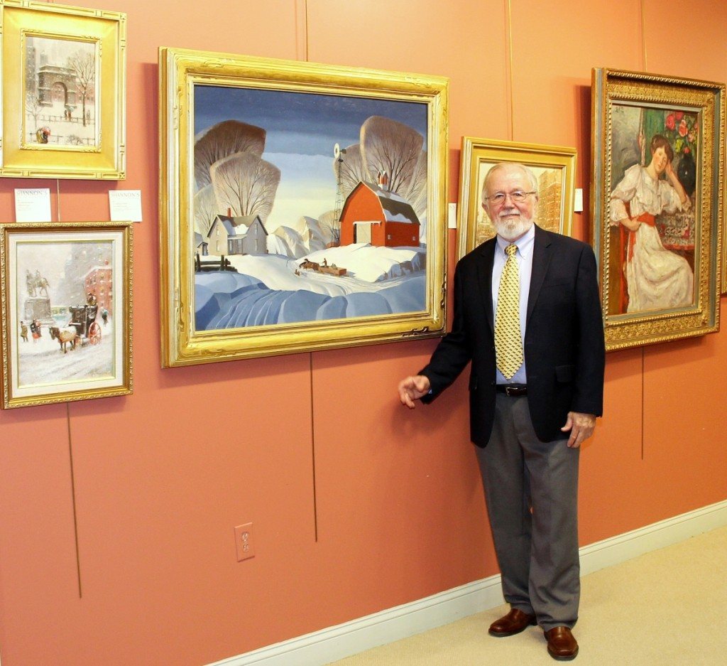 "Gene Shannon with the sale's cover lot, ""Mid-Nation Winter"" by Dale Nichols (1904–1995). The painting by the Nebraska-born artist and illustrator brought $120,000, a record at auction. Left, oil on canvas board paintings by Guy C. Wiggins (1883–1962) included ""Washington Square,"" $9,000 ($10/15,000) and ""Snow Storm at The Plaza,"" $14,400 ($8/12,000). ""Le Repos"" by Georges D'Espagnat (1870–1950) passed at $40/60,000."