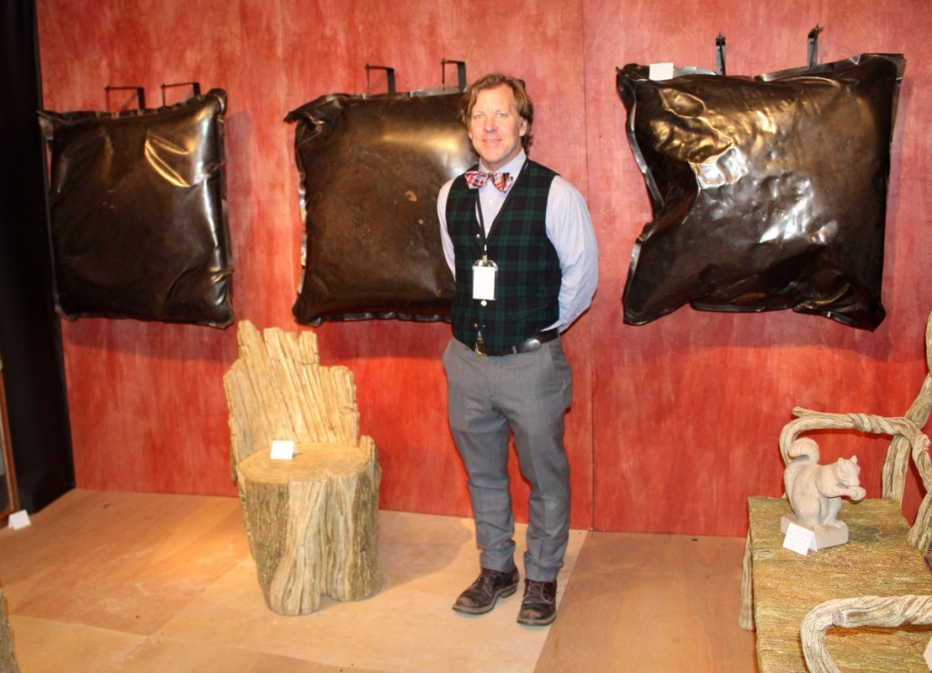 Jeffrey Henkel, Pennington, N.J., with his display of pillow-form sculptures and faux bois garden furniture by Susy Ventura, a vignette that sold completely during the show.