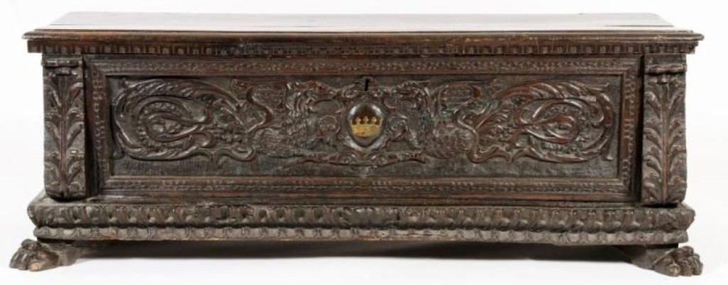 This Sixteenth Century, Italian, walnut cassone, having a central carved cartouche with a crown flanked by two dragons, and gadrooned edges and paw feet, fetched $6,562. It came out of the historic Astor Courts Beaux Arts building in Rhinebeck, N.Y.