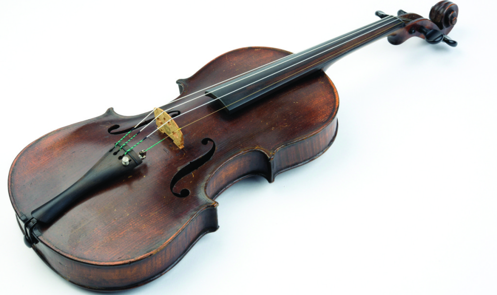 Violins by legendary makers realize enormous prices. The history of adding an impressive but  fake label to an ordinary old fiddle goes back to the Nineteenth Century. This violin from that era was trying to pass itself off as a Stradivarius. Visitors can listen to recordings that demonstrate the difference in sound quality between a real Strad and a less distinguished instrument.