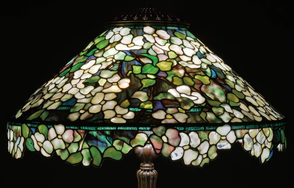 This rare Tiffany Studios floor lamp with all over dogwood design and an unusual irregular floral lower border led the day, blowing through its estimate of $100/150,000 to reach $406,600.