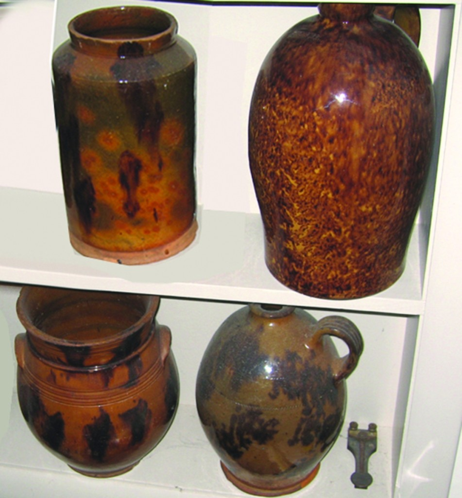 "Four of the redware pieces reported stolen, including, at upper right, a speckled-glaze redware jug marked ""John Bell"" on the shoulder."