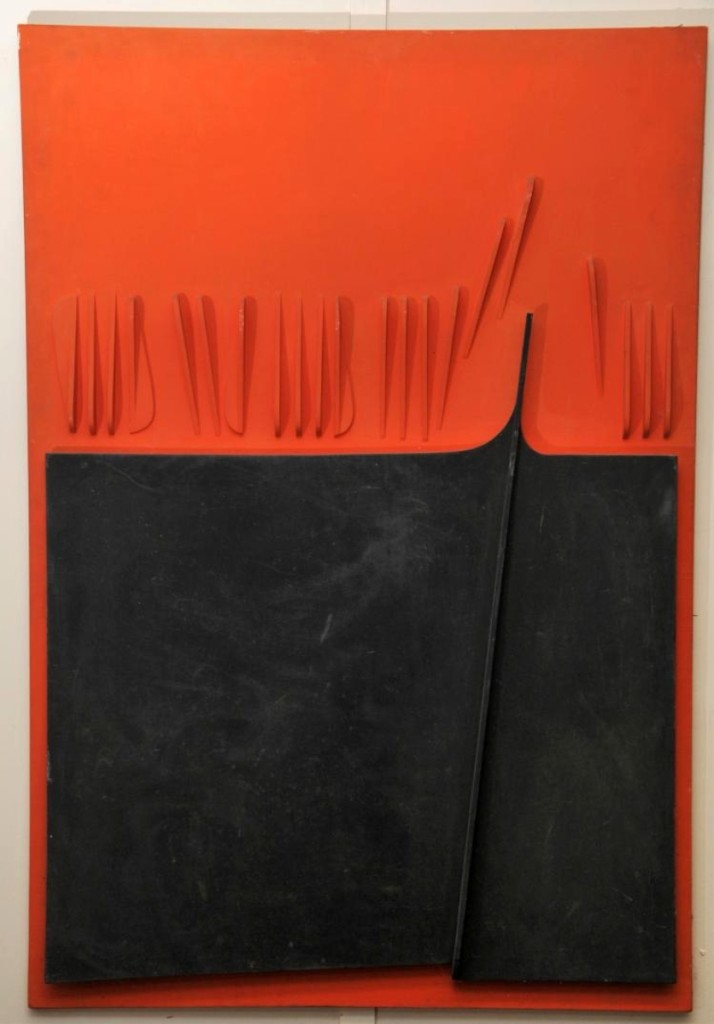 """One of the higher priced items in the sale was this 1960 painted plywood, abstract three-dimensional painting by Ramirez. It was titled """"Red Percussion"""" and it attained $28,080."""