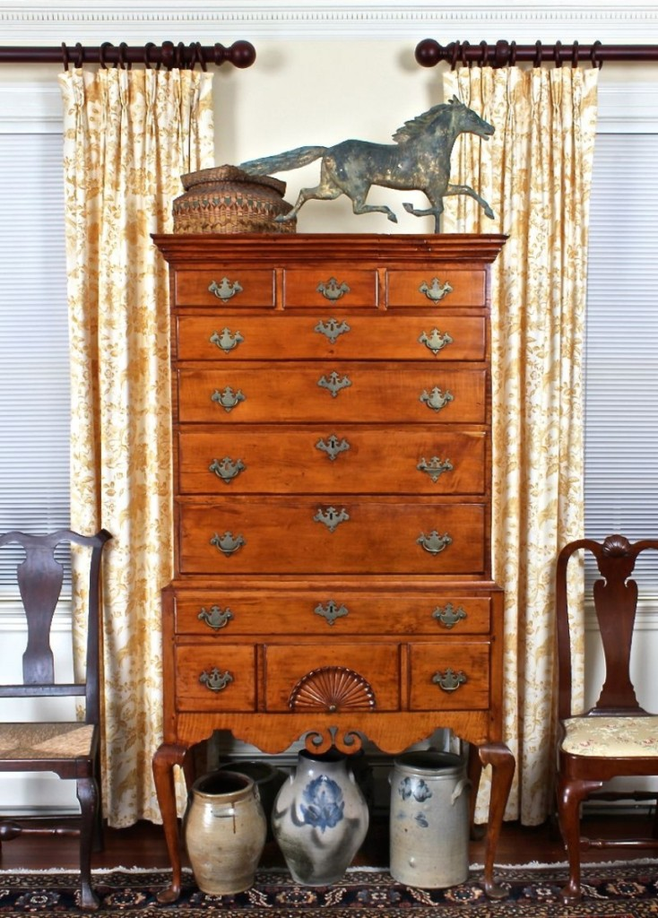 A focal point of the living room was the late Eighteenth Century Dunlap school maple high chest of drawers from New Hampshire, paired here with a molded copper Smuggler running horse weathervane, stoneware and one of many baskets for sale.