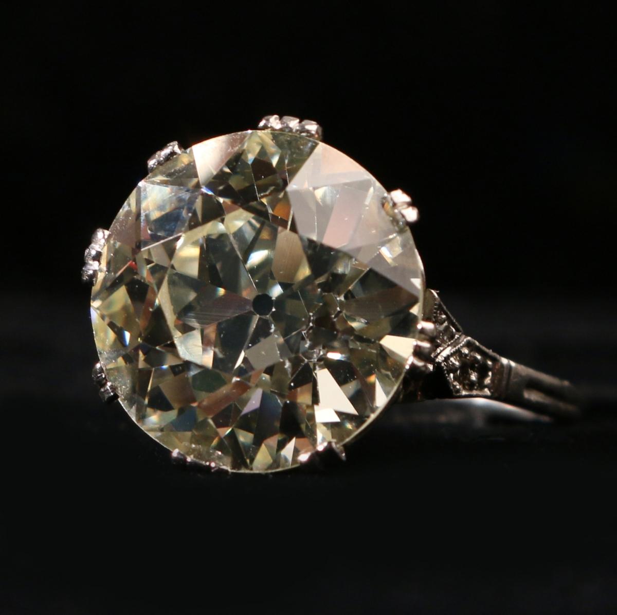This 9.87-carat old European cut diamond, light yellow, attained $72,000.