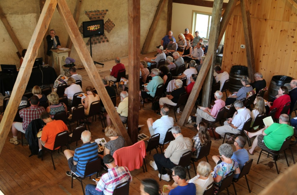 A view from the balcony reveals old beams rising around the packed audience at the Gorsuch Barn.