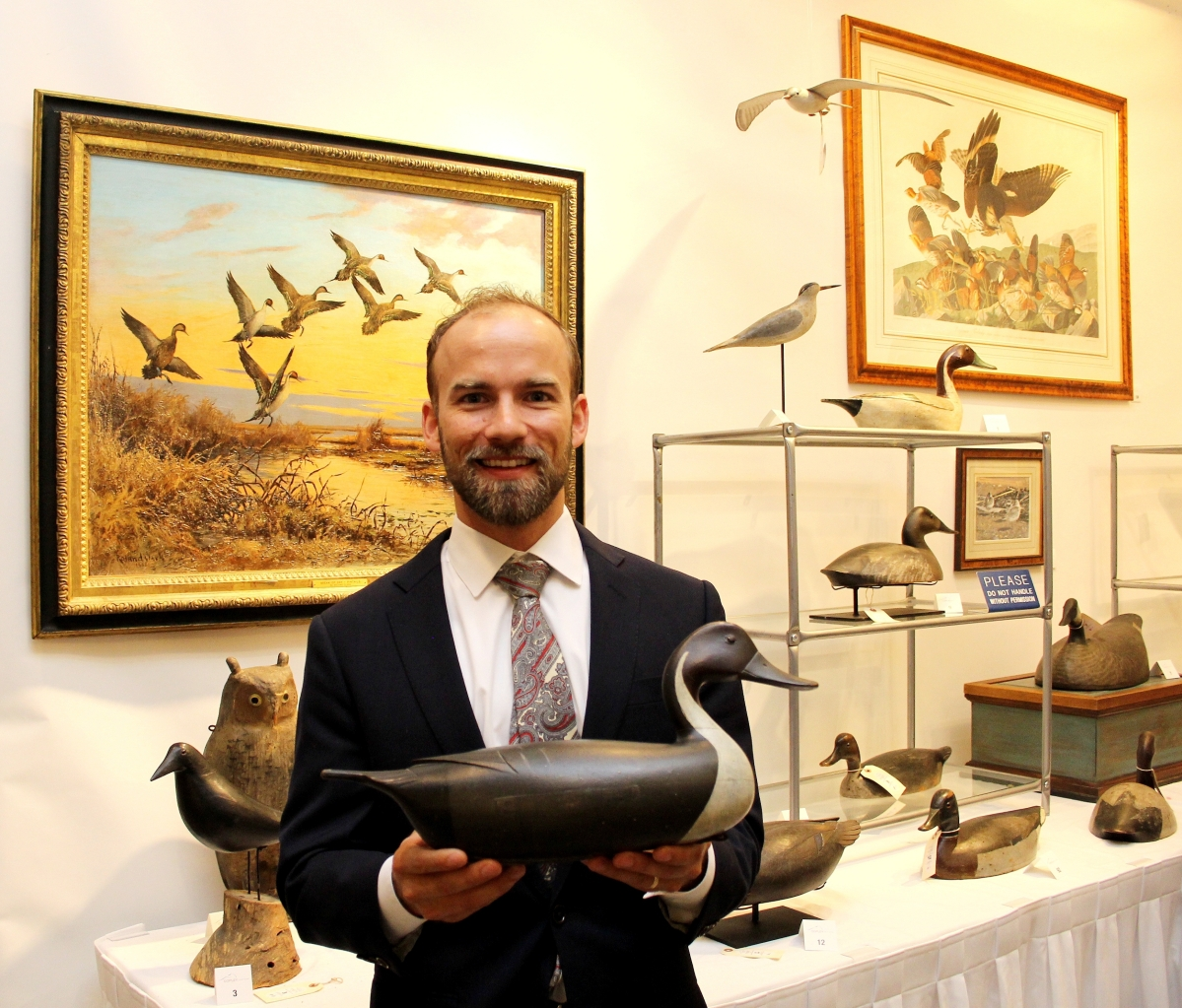 """It's by an A-list maker and is an absolutely singular example. It managed to survive for well over a hundred years,"" Copley Fine Art decoy specialist Colin McNair said of the John English pintail drake, auctioned for a record $246,000 ($80/$120,000). Above left, ""Break of Day — Pintails"" by Roland H. Clark (1874–1957), 1935, oil on canvas, $33,000 ($20/30,000). Above right, ""Virginian Partridge (No. 16, Plate LXXVI)"" after John James Audubon (1785–1851), 1830, hand colored engraving, $63,000 ($10/$20,000)."