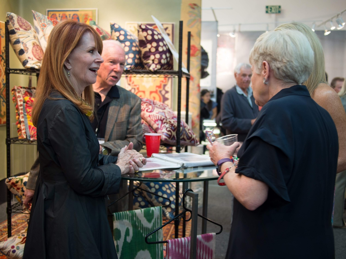From left, Helen Thompson, author of Marfa Modern, and exhibitor Casey Waller of Caravanserai, Ltd, talk with showgoers in Waller's booth. Photo courtesy Objects of Art.
