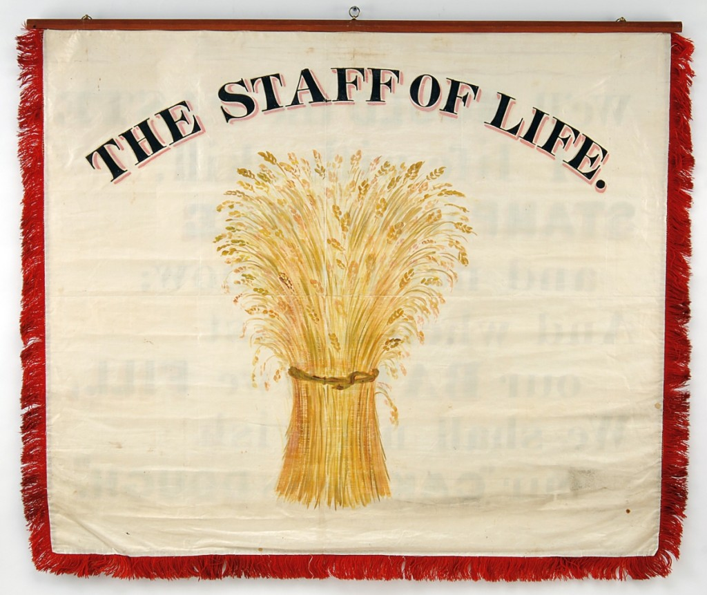 "The reverse reads, ""We'll Mould the Paste of life with skill, Stamp it for Use and not for show; And when at last our Batch we Fill, We shall not wish our 'Cake was Dough.'"" Bakers and Confectioners banner."