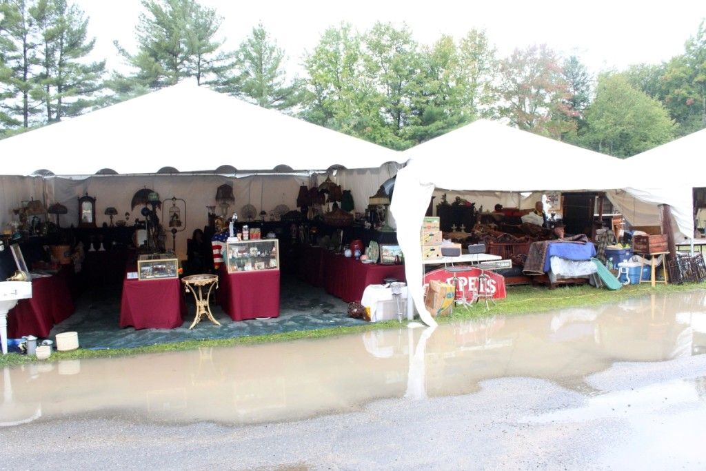 You can see the antiques — but how do you get to them? Puddles galore greeted early shoppers at New England Motel.