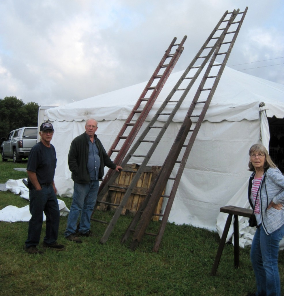 Richard Fuller considers the apple picking ladders offered by Don and Jane Desjardins.