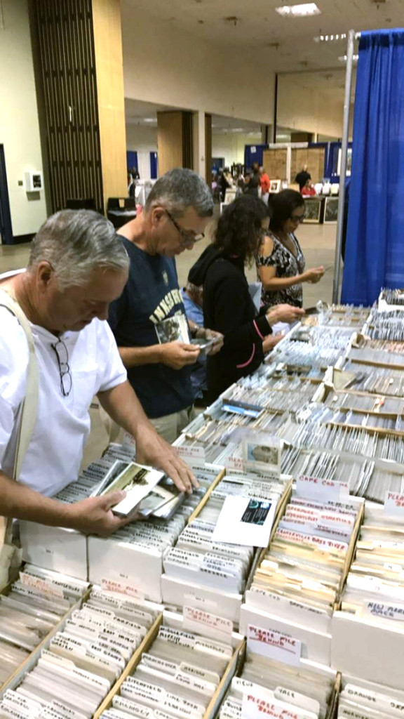 Postcard collectors roam the stacks at every show, and Albany, N.Y., dealer Michael Seaman, set up near the show's main entrance, is always on their list.  —Sean Kutzko photo