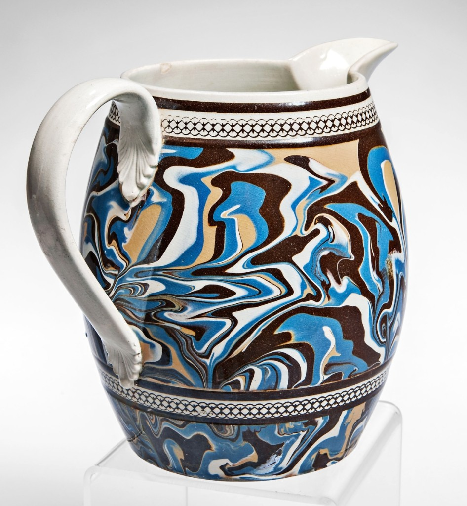 The sale started with mocha from the Jonathan Rickard collection, and this was the most popular piece. The 9-inch slip-marbled pearlware jug, circa 1800, was predominately blue with swirls of brown, yellow and white. It realized $8,610.