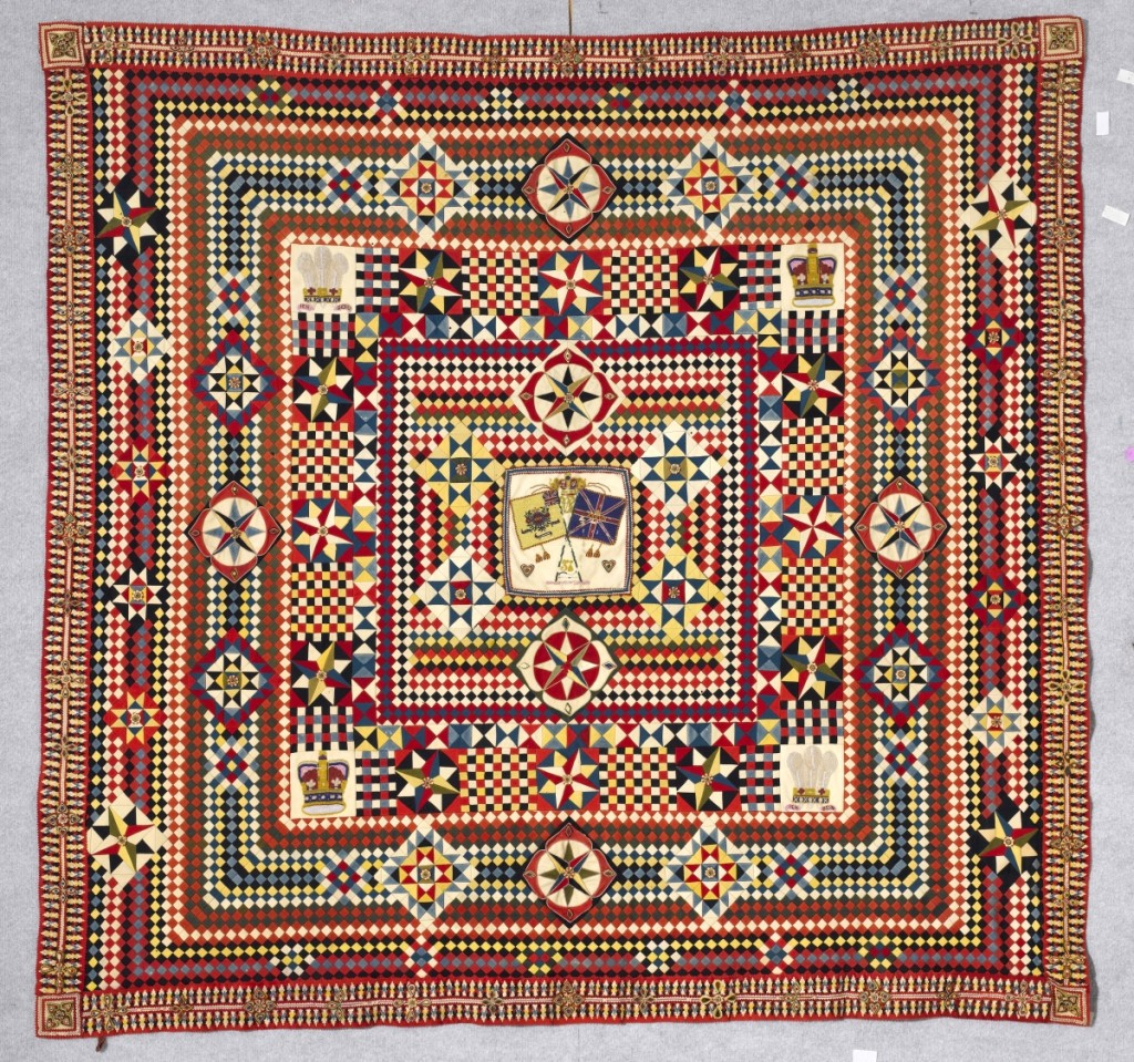 Soldier's quilt with incredible border, artist unidentified, India, circa 1855–75, wool from military uniforms, with beads, hand applied beadwork and layer-appliquéd border, 82 by 85 inches; The Annette Gero Collection. —Tim Connolly, Shoot Studios photo