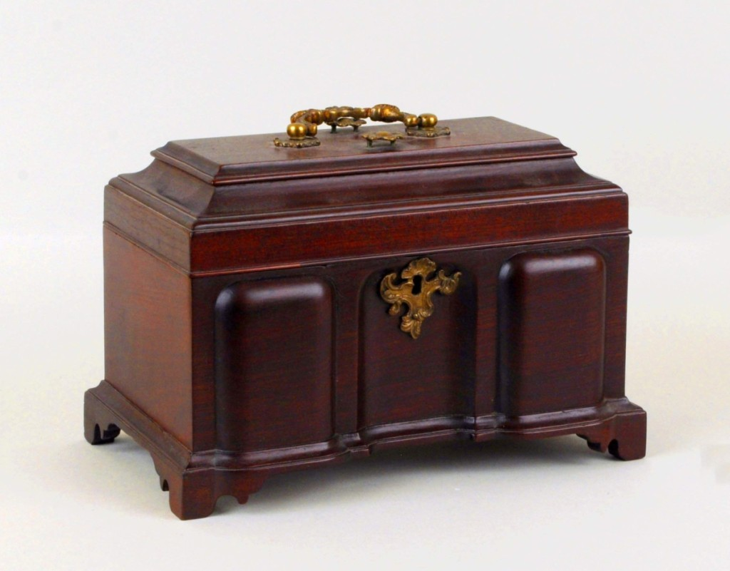 C.K. Davis acquired this rare blockfront caddy, only 7½ inches tall and made of mahogany with red cedar secondary wood, from Israel Sack, Inc, in 1939. Eleven years before, Wallace Nutting illustrated the Eighteenth Century novelty in his Furniture Treasury. Probably from Newport or Boston, it sold to a phone bidder for $18,000.
