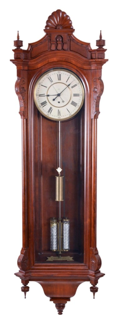 Schmitt's catalog stated this was the first time in 38 years that the company had offered a Seth Thomas No. 19 jewelers hanging regulator in an uncommon cherry case. The description also noted that the mercury in the pendulum would require special handling. The circa 1886 clock finished at $17,250.