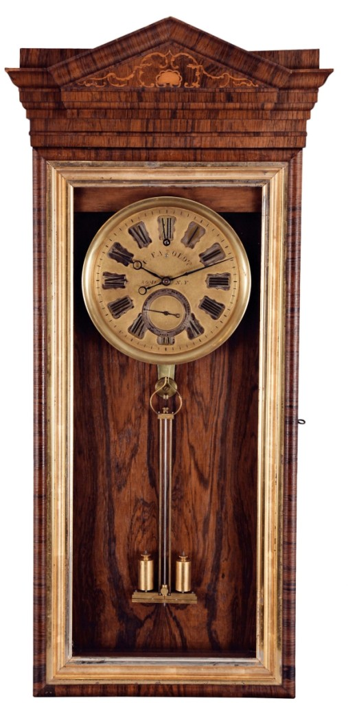 The auction's top selling clock, at $141,600, was this 30-day hanging regulator made by Charles Fasoldt, while he was working in Rome, N.Y., about 1859. It was one of only two known clocks from Fasoldt's early years in Rome. Made to the specifications of his 1859 patent escapement and unaltered, it is regarded as the best example known.