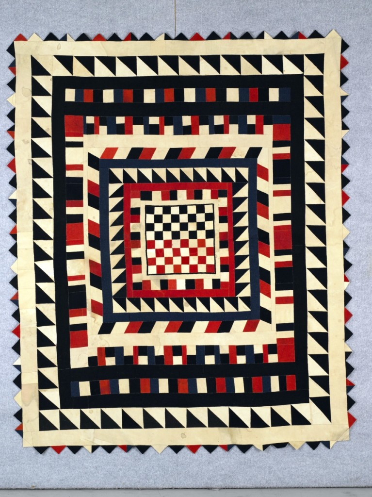 Quilt with inlaid chessboard, artist unidentified, Silesia, mid-Nineteenth Century, wool from military uniforms, 74 by 61 inches; the Annette Gero Collection. —Tim Connolly, Shoot Studios photo