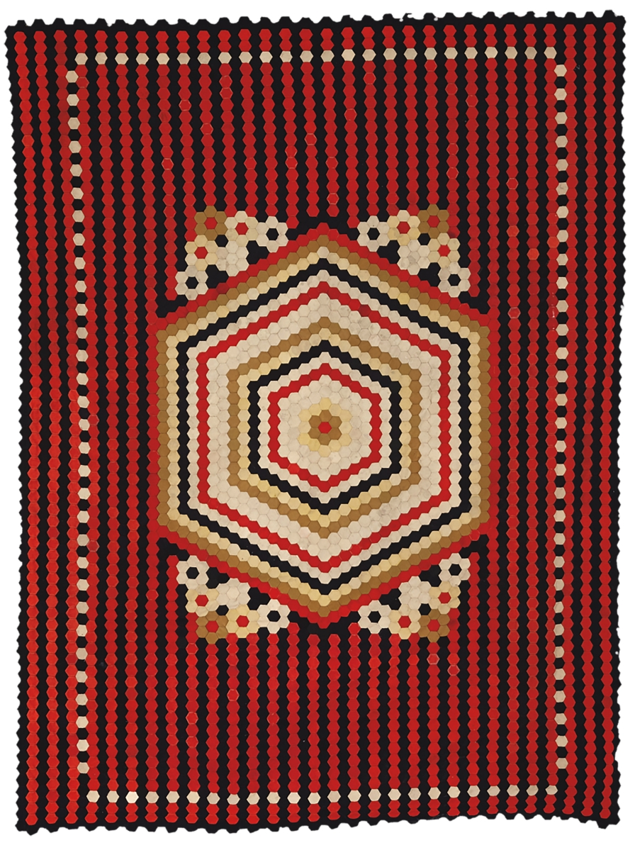Soldier's hexagon quilt, artist unidentified, Crimea or United Kingdom, late Nineteenth Century, wool from military uniforms, 85 by 64 inches; the Annette Gero Collection. —Tim Connolly, Shoot Studios photo